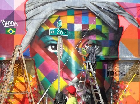 Street artists adorn the walls of Wynwood with their graffiti