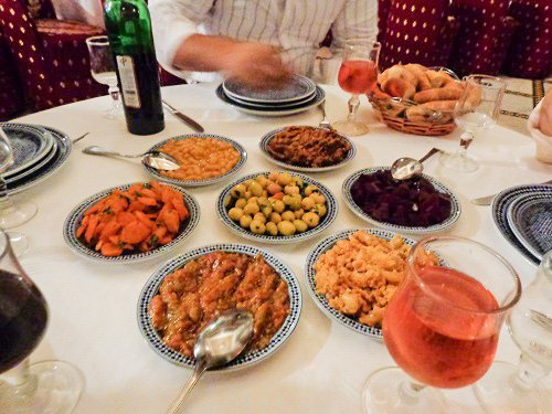 Small plates of shareable Moroccan dishes.