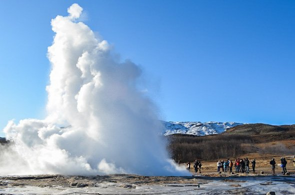 The power of the Strokkur geyser propels water over 100 feet high.