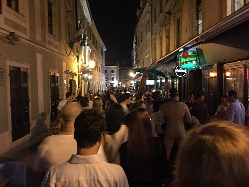 People are out until the wee hours in Old Town on a Saturday night.