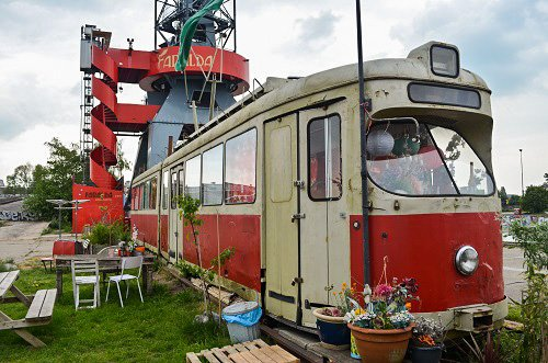 The wharf is also home to two abandoned train cars which have been decorated like trailer homes.